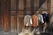 stock photo of clothes hanger  - The washing and drying clothes at the door in the rural areas of Thailand - JPG