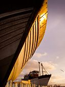 Wooden Hull Of Boat At Sunset In Drydock