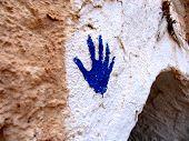 stock photo of hamsa  - Blue fatimas hand on the white wall - JPG