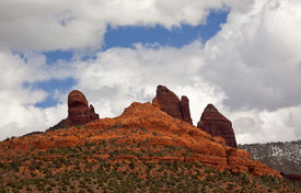 foto of snoopy  - Snoopy Rock Butte Orange Red Rock Canyon Blue Cloudy Sky Green Trees Sedona Arizona - JPG
