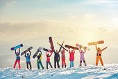 Big Group Of Happy Friends Skiers And Snowboarders Having Fun And Holding Ski And Snowboards On Moun poster