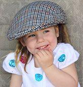 Young girl wearing flatcap