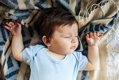 Little Baby Sleeping Calm In Bed At Home, Blue And White Blanket Background. Childhood, Maternity An poster