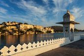 India luxury tourism concept background - Udaipur City Palace from Lake Pichola. Udaipur, Rajasthan, poster