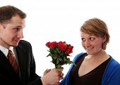 Man Gives A Bunch Of Flowers To A Women
