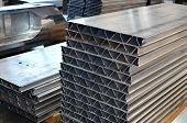 Aluminum Profile In The Production Hall Of An Industrial Plant. Automotive Components Manufacturing poster
