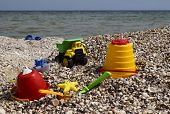 Plastic Childrens Toys For Sand On The Background Of The Sea. poster
