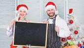 Menu For Our Family. Man And Woman Chef Santa Hat Near Christmas Tree Hold Blackboard Copy Space. Ch poster