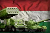 Tank And Missile Launcher With Summer Pixel Camouflage On The Hungary Flag Background. Hungary Heavy poster