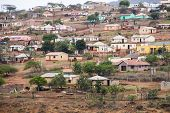 Colorful Huts And Housing Scattered Informally On Steep Hillside In South Africa poster