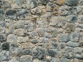Texture Old Rock Wall Made Of Random Stone Background. Closeup Texture Background Image Of Natural R poster