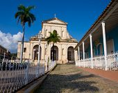 Old cathedral near the central square in the colonial town of Trinidad in Cuba, a famous touristic landmark on the caribbean island poster