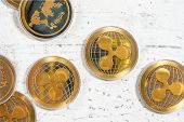 Detail On Xrp Ripple Cryptocurrency Golden Coins On White Stone Like Board, Photographed From Above poster