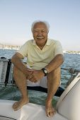 stock photo of early 60s  - Man on Sailboat - JPG