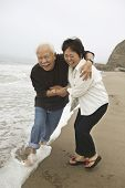 picture of early 50s  - Mature Couple Playing in Water - JPG