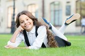 Cheerful Schoolgirl. Relax At School Yard. Nice Time. School Break For Rest. Happy Smiling Pupil. Gi poster
