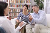 married couple consults talking to psychologist