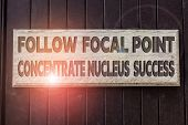 Conceptual Hand Writing Showing Follow Focal Point Concentrate Nucleus Success. Business Photo Text  poster