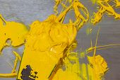 Yellow Color Of Ink For Print Tee Shirt. Plastisol Ink In White Barrel Are Dripping. Plastisol Ink U poster