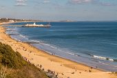 Bournemouth Pier In Distance And Sands On Sunny Spring Day. United Kingdom, Landscape. poster