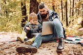 Modern Family. Forest School And Ecology Education. Man Bearded Father And Son With Laptop In Forest poster