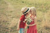 Happy Kid On Summer Field. Cute Little Children Enjoying At Countryside. Kids Having Fun In Green Fi poster