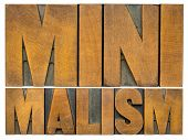 minimalism  - isolated word abstract in vintage letterpress wood type printing blocks, simplicity, m poster