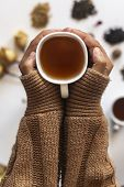 Winter Time. Women Drinking Hot Tea During Cold Winter Holidays. Woman Holding A Cup Of Tea With Tea poster