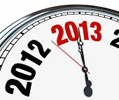 The year 2013 is quickly approaching according to this white clock with hands pointing to the number