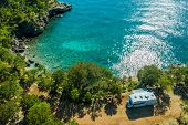 Aerial Photo Of Scenic Sea Front Rv Campsite. Modern Motorhome Camper Van On The Mediterranean Sea C poster