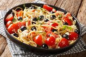 Traditional Greek Pasta Spaghetti Salad With Cheese, Olives, Tomatoes Close-up On A Plate. Horizonta poster