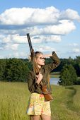 Blondie Girl With A Hunting Rifle.