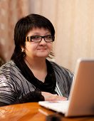 picture of senorita  - Office Woman indoors with a laptop - JPG