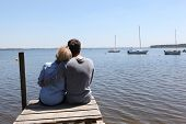 image of pontoon boat  - Couple sitting on a pontoon - JPG