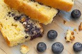 slices of fresh cornbread with blueberry on cutting board