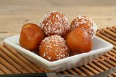 stock photo of mithai  - asian gulab jamun on a white dish with coconut - JPG