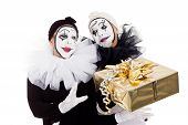 A Couple Clowns With A Golden Present