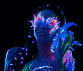 picture of uv-light  - Portrait of beautiful woman with body art glowing in ultraviolet light - JPG