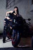Sexy brunette woman biker