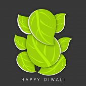 Creative illustration of Hindu mythology Lord Ganesha made with green leaves on dark abstract background for Indian festival of lights, Happy Diwali.