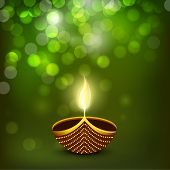 Indian festival of lights Happy Diwali greeting card or background with illuminated oil lit lamp on