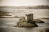Stalker Castle, Loch Linnhe, Appin, Scotland. Vintage style processing.