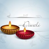 Indian festival of lights, Shubh Diwali (Happy Diwali) greeting card with illuminated colorful oil lit lamp on floral decorated background.
