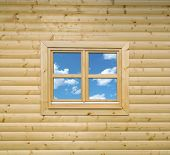 stock photo of chalet  - Wooden Cottage Wall of Chalet with Window - JPG