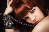 beautiful brown-haired woman in handcuffs