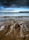 Long Exposure Seascape Landscape During Dramatic Evening In Winter