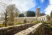 foto of church-of-england  - The Church of St Nonna and Pack Horse bridge at Altarnun on Bodmin Moor Cornwall England UK Europe - JPG