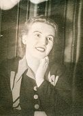 LODZ, POLAND, CIRCA 1940's: Vintage portrait of woman smiling