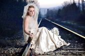 image of nervous breakdown  - A view of a disappointed bride on a railway - JPG
