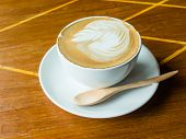 stock photo of latte  - latte hot coffee on wood table in coffee shop